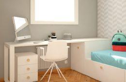escritorio esquinero junto a cama